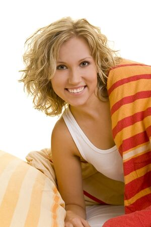 Young blonde woman in bed smiling photo