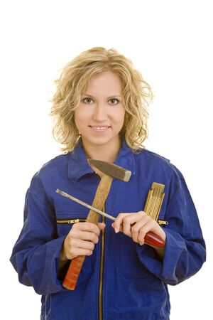 Young woman in a blue overall with tools in her hand photo