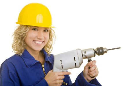 Young woman with helmet and a drill  machine photo