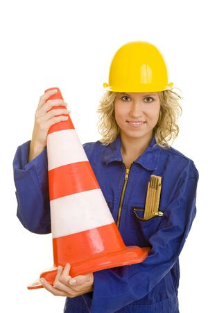 Young woman with helmet and a jumpsuit holding a traffic cone photo