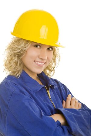 Young female worker in a blue jumpsuit and a yellow hardhat Stock Photo - 3942402