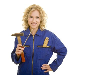 Young blonde woman in a blue jumpsuit holding tools photo