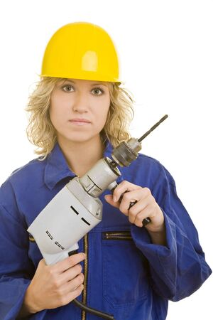 Blonde woman in a blue jumpsuit with helmet and a drill machine photo
