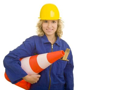 female construction worker: Blonde female construction worker carrying a traffic cone