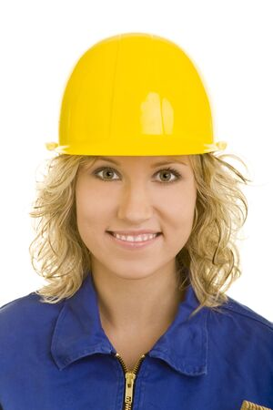 Blonde woman in a blue jumpsuit wearing a yellow hardhat photo