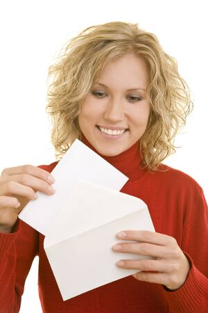 Blonde young woman opening a letter