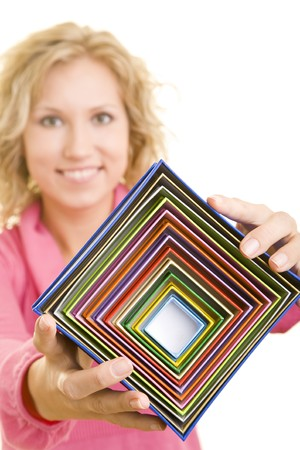 Blonde woman holding colorful gift boxes photo