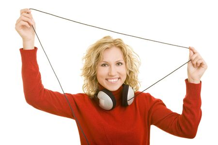 Blonde woman holding the cable of her headphones photo