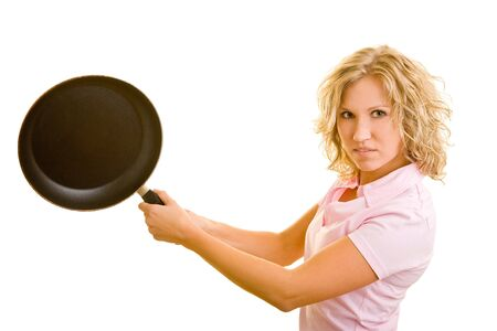 Young woman uses a frying pan as a bat photo