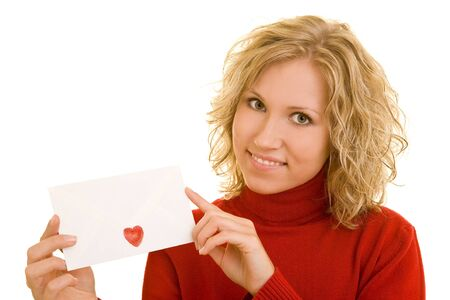 Blonde woman showing a letter with a heart-shaped sticker on it photo