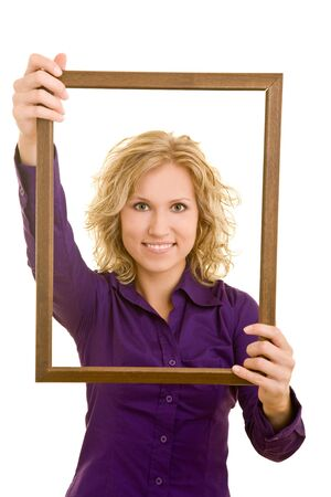 Blonde woman holding an empty wooden frame photo