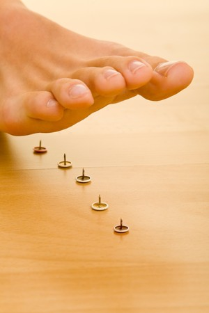 stepping: Foot about to walk on pins