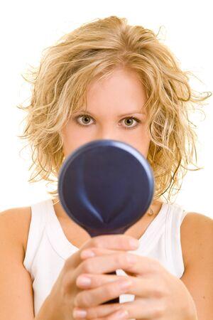 hypnotist: Blonde woman looking in a hand mirror