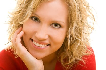 Young blonde woman smiling happily photo