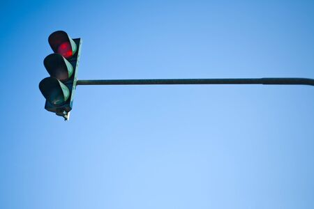 red traffic light: Red traffic light with blue sky Stock Photo