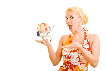 Blonde woman holding a shopping cart with a piggy bank inside photo