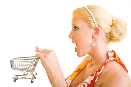 Blonde woman pushing a small shopping cart photo