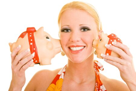 Blonde woman gets kissed by two piggy banks Stock Photo - 4278523
