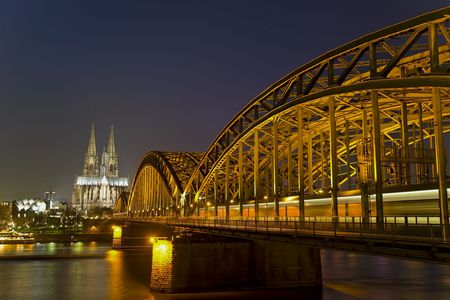 ludwig: River Rhine, Bridge and Cologne Cathedral in Germany at Night Stock Photo