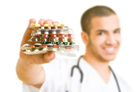 Doctor holding a stock of pills photo