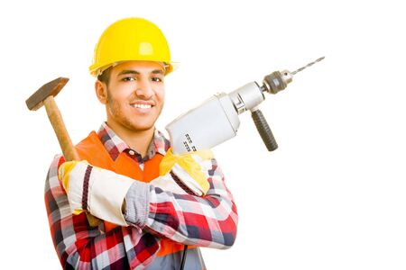 Worker holding a hammer and a drilling machine photo