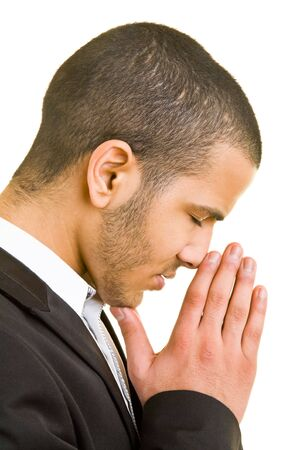 man side view: Young business man folding his hands for a prayer Stock Photo