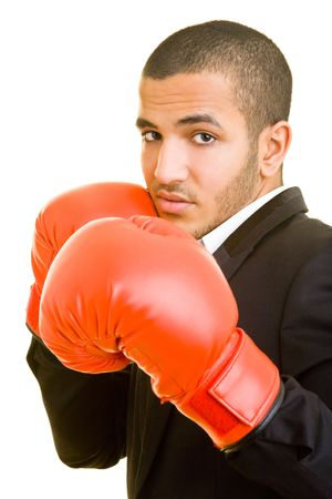combative sport: Young business man with red boxing gloves Stock Photo