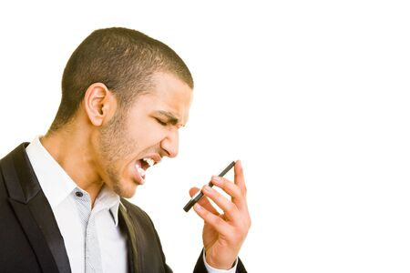 Young business man screaming into his mobile phone Stock Photo