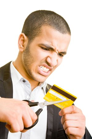 Frustrated business man cutting a credit card photo