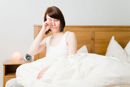Young woman waking up in her bed Stock Photo - 4842921