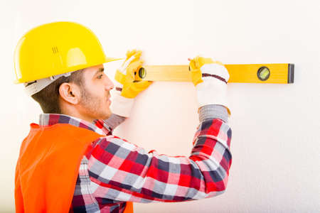 Construction worker using a water level photo
