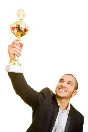 aloft: Happy business man holding a trophy aloft