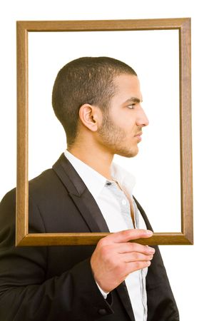 man face profile: Business man holding an empty frame in front of his head Stock Photo