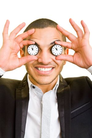 Happy manager holding watches in front of his eyes photo