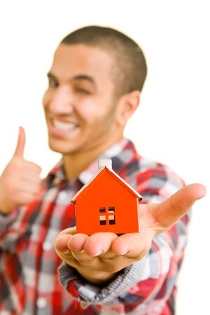 Man holding a miniature house on his palm Stock Photo - 4946294