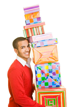 carry out: Man carrying a stack of presents Stock Photo