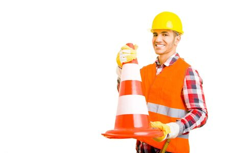 Construction worker holding a traffic cone photo