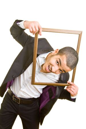 Young business man putting his head through an empty frame photo
