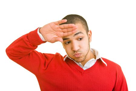 Young man wiping his forehead with his hand photo