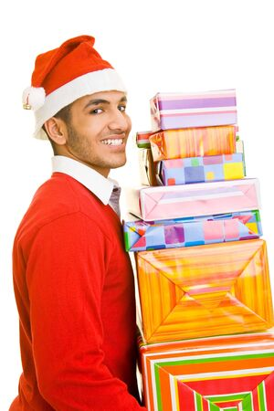 Man with christmas hat carrying many gifts photo
