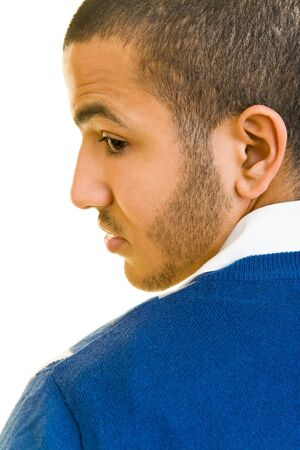 over the shoulder: Young man looking over his shoulder Stock Photo