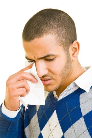Sad man drying his tears with a paper tissue photo