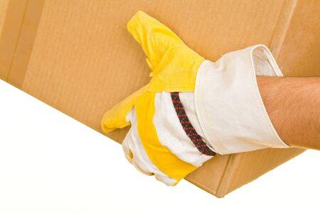 pappkarton: Hand mit Handschuhen mit einem Karton Lizenzfreie Bilder