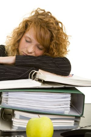 Young redhaired woman sleeping on a stack of files Stock Photo - 5138465