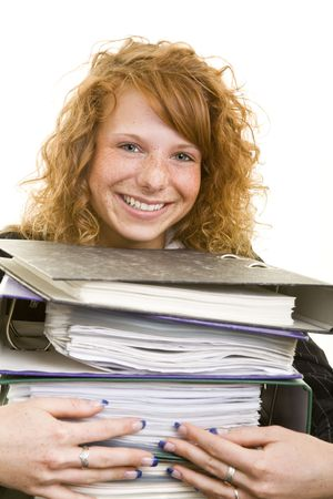 Young redhaired woman embracing a stack of files Stock Photo - 5138469