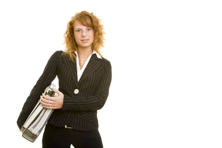 Young redheaded woman in a business suit carrying files Stock Photo - 5133713