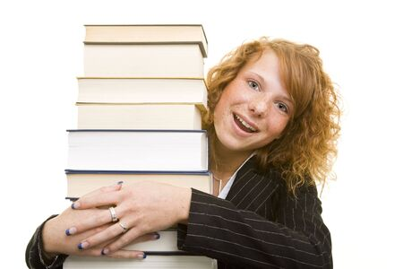 Young redhaired woman with books smiling Stock Photo - 5133710