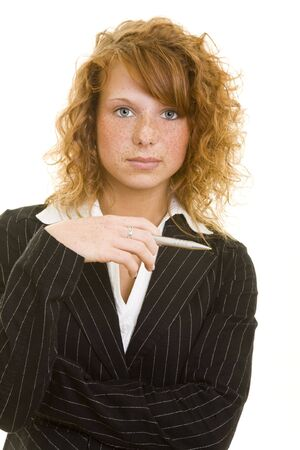 Young redhaired woman in a business suit Stock Photo - 5133734