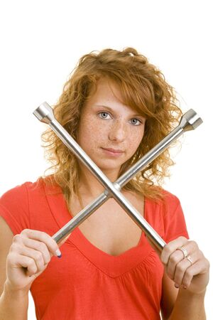 Young redhaired woman with a cross-wheel-type wrench photo