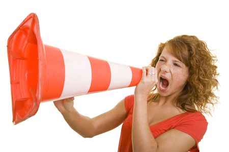 pep: Young redhaired woman screaming in a traffic cone